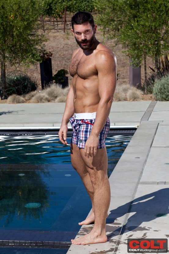 Bearded-muscle-hunk-Bob-Hager-jerks-off-by-the-pool-01-Ripped-Muscle-Bodybuilder-Strips-Naked-and-Strokes-His-Big-Hard-Cock-photo