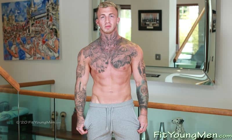 Straight tattooed muscle stud Nathan Harris strips down to his long sports socks and undies jerking his huge uncut cock