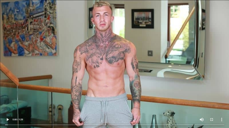 Hot tattooed straight muscle hunk Nathan Harris strips naked jerking his huge uncut dick to a massive load of cum